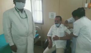 SafeValue must use [property]=binding: বেঙ্গালুরুতে করোনার টিকা নিলেন কেন্দ্রীয় মন্ত্রী সদানন্দ গৌড়া (see http://g.co/ng/security#xss)