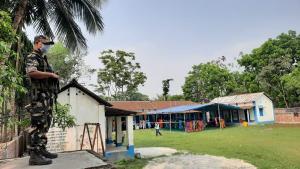SafeValue must use [property]=binding: ফালাকাটার একটি বুথে কেন্দ্রীয় বাহিনীর নজরদারি (see http://g.co/ng/security#xss)